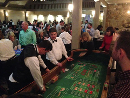 People playing craps at a party
